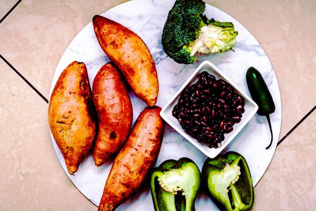 Photo displaying stuffed sweet potato ingredients. Black beans, broccoli, cpasicum and jalapeno.