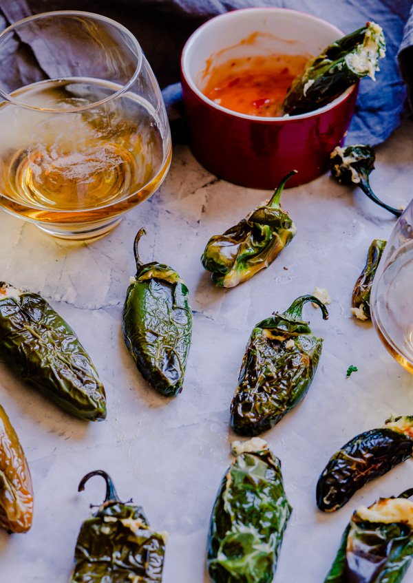 Jalapeno poppers air fried and served with beer.