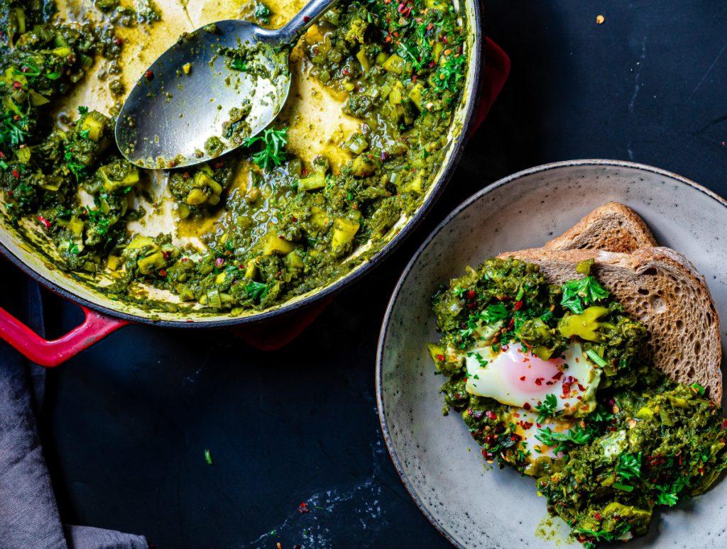 green shakshuka served on toast